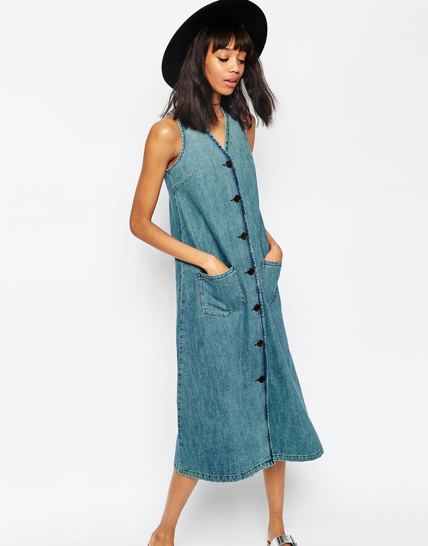 This sleeveless denim tank dress by Denim & Co. keeps your layering options open. A fabric belt at the waist allows you to show off your curves, or keep things /5.