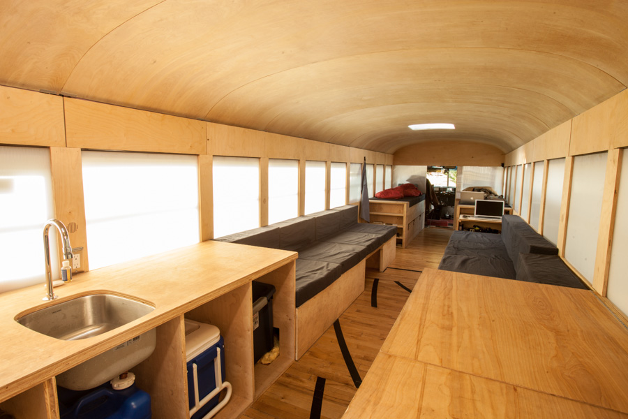 Architecture Student turned a school bus into a cozy mobile home 3