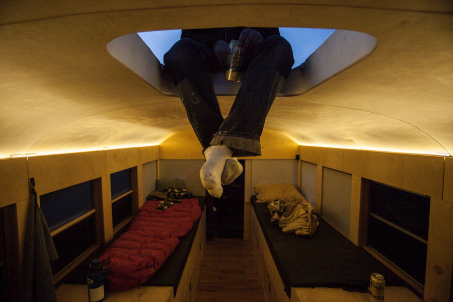 Architecture Student turned a school bus into a cozy mobile home
